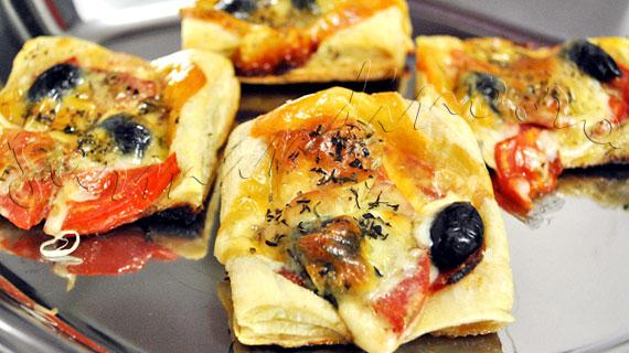 Reteta de aperitiv napoletan, din aluat foietaj, cu salami, ansoa, masline si mozzarella