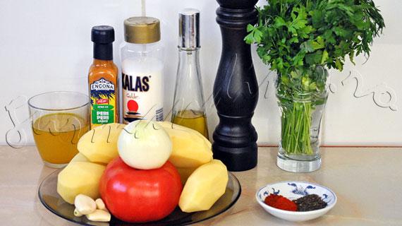 Cartofi portughezi - reteta de garnitura de cartofi cu sos picant de rosii